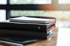 Stack of notebooks and pens on office desk.  stock image