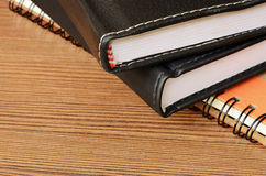 Stack of notebooks on a table royalty free stock photo