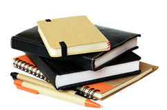 Stack of notebooksand pens royalty free stock image