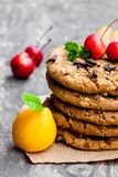 Stack  of oat cookies with quince and wild apples on wooden back Royalty Free Stock Photo