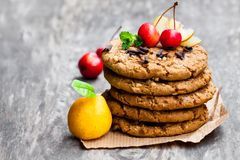 Stack  of oat cookies with  quince and wild apples on wooden back Royalty Free Stock Photography