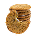 Stack of oatmeal crème cookies with one bitten Royalty Free Stock Photography