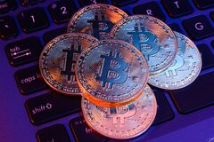 Free Stack Of Bitcoins On Keyboard Royalty Free Stock Photography - 182157757