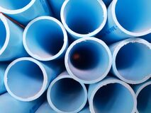 Free Stack Of Blue Water Pvc Pipe On The Rack Background Texture Cut To Edge Stock Images - 182622704