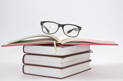Stack Of Books With Opened Notebook And Glasses Royalty Free Stock Images
