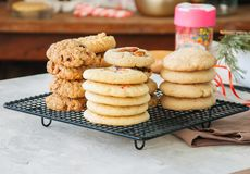 Free Stack Of Different Festive Cookies On A Wire Rack. Preparation T Stock Image - 103912091