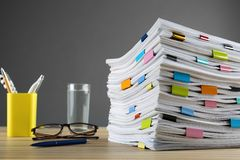 Free Stack Of Documents With Binder Clips And Glasses On Wooden Table Stock Images - 157883494