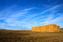 Stack Of Hay Bales In Plowed Field Royalty Free Stock Photo
