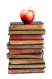 Stack Of Old Books And Apple On It Royalty Free Stock Photos