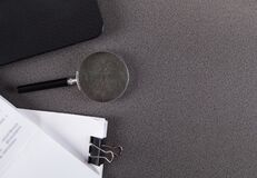 Free Stack Of Paper Documents With Magnifying Glass And Computer, On Table Stock Image - 215863291
