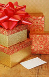 Stack Of Presents In Gold And Red Stock Image