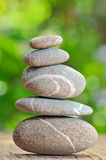 Stack Of Stones On A Wooden Table Royalty Free Stock Photo