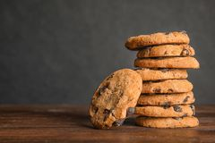 Free Stack Of Tasty Chocolate Chip Cookies On Wooden Table. Royalty Free Stock Photos - 132203178