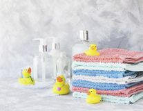 Free Stack Of Towels With Yellow Rubber Bath Ducks On White Marble Background, Space For Text, Selective Focus Royalty Free Stock Photo - 87441085