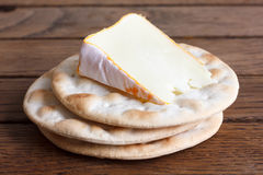 Free Stack Of Water Biscuits With Cheese On Wood. Royalty Free Stock Photo - 55462485