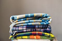 Stack Of Woolen Checked Blankets Royalty Free Stock Image