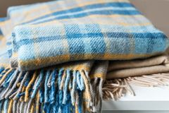 Stack Of Woolen Checked Blankets Royalty Free Stock Photos