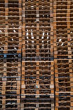 Stack off wooden pallets. Stack of old wooden pallets used for transport of goods Stock Images