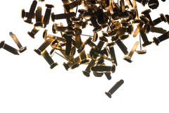 Stack of office supplies brass fasteners paper clips on royalty free stock image