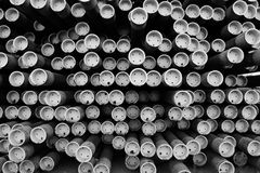 Rack of metal pipes, oil and gas drilling, abstract. Large rack of iron metal pipes used for oil and gas drilling and extraction, Wyoming stock images