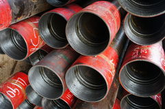 Stack of oil well intemediate casing bundles. At box end of casing stock image