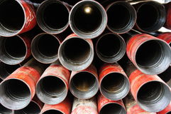 Stack of oil well intermediate casing bundles. At box end of casing stock photo