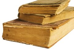 Stack of old antique big books on white background stock photos