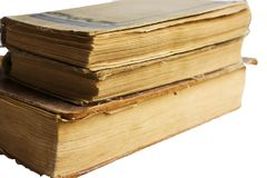 Stack of old antique big books on white background Royalty Free Stock Images