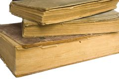 Stack of old antique big books on white background royalty free stock photos