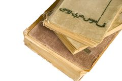 Stack of old antique big books on white background royalty free stock image