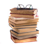 Stack of old antique books and spectacles Stock Photography