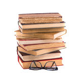 Stack of old antique books and spectacles in thick-rimmed. Stock Photo