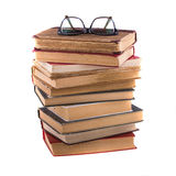 Stack of old antique books and spectacles in thick-rimmed Royalty Free Stock Image