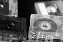 A stack of old audio cassettes. Black and White Stock Image