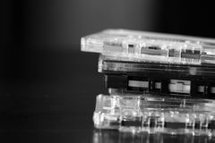 A stack of old audio cassettes. Black and White Royalty Free Stock Image