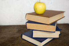 Stack of old big books and apple Royalty Free Stock Photography