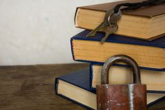 Stack of old big books and lock Royalty Free Stock Images