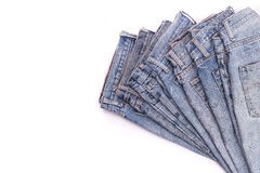 Stack of old blue jeans isolated on white Royalty Free Stock Photos