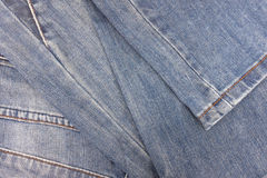 Stack old blue jeans. Royalty Free Stock Photo