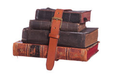 Stack of old book with belt Royalty Free Stock Photography