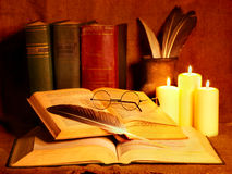 Stack old book and candle. Stock Images
