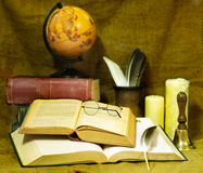 Stack old book and candle. Stock Photos