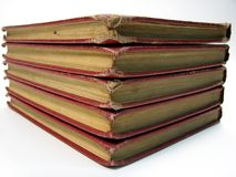 Stack of Old Books. Five tattered old stacked up books Stock Images