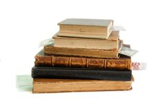 Stack of old books with banknote bookmarks isolate Royalty Free Stock Image