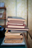 A stack of old books. A stack of old battered books on the table Royalty Free Stock Photography