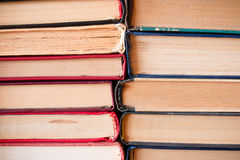 Stack of old books binding. To each other Royalty Free Stock Image