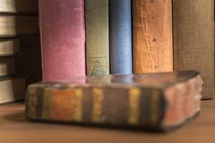 Stack of old books. Detail photograph of a stack of old books in which the texture of the covers can be seen Royalty Free Stock Photos