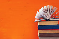 stack of old books in front of wooden background Royalty Free Stock Photo