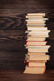 Stack of old books. In front of wooden wall. School background. Education backdrop Royalty Free Stock Images