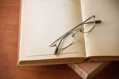 Stack of old books and glasses Stock Photos
